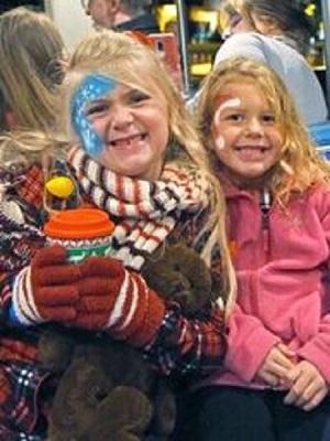 Children enjoying hot cocoa at the North Carolina Zoo