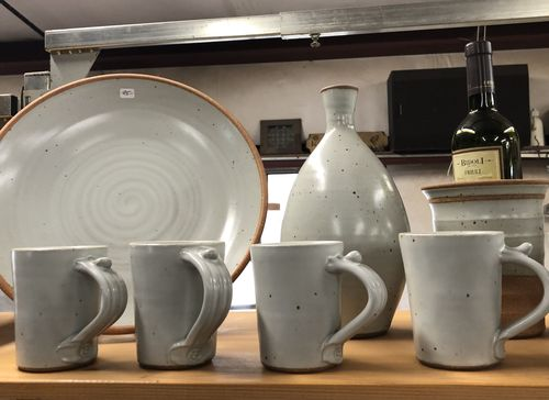 Winter white pottery plates and mugs created by Tom Gray in Seagrove NC